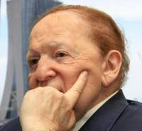 Las Vegas Sands CEO and Chairman Sheldon Adelson speaks during a media briefing with the backdrop of Singapore's Marina Bay Sands on Dec. 21, 2009 in Singapore.