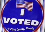 """I Voted"" stickers are displayed at an early voting site in a Cardenas supermarket in Las Vegas Wednesday, Nov. 2, 2016."