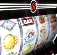 Scientific Games plans to pay about $3.3 billion to buy Bally Technologies in a deal that would combine makers of gambling equipment ranging from slot machines to instant-win lottery games. The electronic gambling machine maker said Friday that it will...