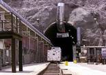 In this July 14, 2018, photo, people leave the south portal of Yucca Mountain during a congressional tour near Mercury. Several members of Congress toured the proposed radioactive waste dump 90 miles northwest of Las Vegas.