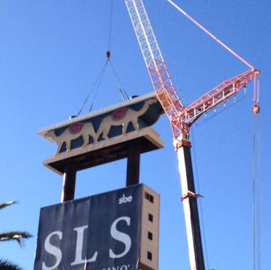 A piece of Las Vegas' past vanished from the Strip on Tuesday, as workers removed the sign from the old Sahara resort. The sign is being removed as part of a project to transform the Sahara into SLS Las Vegas.