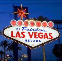 Tourists pose in front of the iconic Welcome to Fabulous Las Vegas sign Tuesday, March 6, 2012.