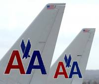 An unspecified threat prompted authorities to remove passengers from an American Airlines plane preparing to depart Las Vegas and search it with dogs, according to airport and airline officials.