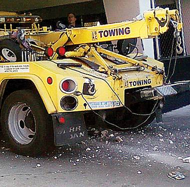 A tiny dirt lot in downtown Las Vegas became ground zero for bewildered vehicle owners who found their cars had been towed. Downtown resident John Delibos pulled into the lot and found ...