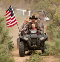 Ryan Bundy, son of Nevada rancher Cliven Bundy, rides an ATV into Recapture Canyon north of Blanding, Utah, on Saturday, May 10, 2014, in a protest against what demonstrators call the federal government's overreaching control of public lands. The area has been closed to motorized use since 2007 when an illegal trail was found that cuts through Ancestral Puebloan ruins. The canyon is open to hikers and horseback riders.