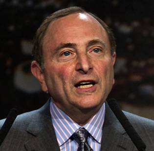 "Gary Bettman, commissioner of the NHL, addresses the crowd as Bill Foley, chairman of Fidelity National Financial Inc., Black Knight and FIS, listens during the ""Let's Bring Hockey to Las Vegas!"" press conference Tuesday, Feb. 10, 2015, at MGM Grand Ballroom."