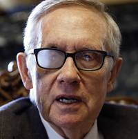 Senate Minority Leader Harry Reid (D-NV) talks with reporters following a groundbreaking ceremony for the Interstate 11/Boulder City Bypass project near Boulder City Monday, April 6, 2015.