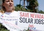 Protestors, including Ronald Brittan, right, line up along the street during a rally in front of NV Energy Wednesday, April 22, 2015, in Las Vegas. Hundreds of activists gathered outside NV Energy headquarters in Las Vegas to protest a state cap affecting rooftop solar installations and urge the Legislature to lift it.