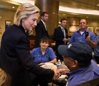 Democratic presidential candidate Hillary Clinton greets workers at the Aria in Las Vegas before addressing the  National Association of Latino Elected and Appointed Officials on Wednesday, June 18, 2015.