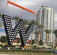 "It was too early to light up the giant letter ""W,"" some 13,500 pounds of sheet metal, lights and wiring lifted atop the large video sign of the SLS Las Vegas Friday morning. The letter was placed there to advertise the SLS's relationship with ..."
