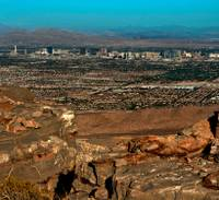 After two hours of public comments Tuesday night, Clark County planners voted against a controversial proposal to develop a master-planned community on a hill overlooking Red Rock Canyon.  The Planning Commission's unanimous vote ...