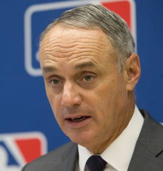 Baseball Commissioner Rob Manfred speaks to reporters during a news conference at Major League Baseball headquarters in New York, Thursday, May 19, 2016.