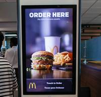 Customers walking to the checkout area of a southwest valley McDonald's can see that the technological future of fast-food ordering and customer service has arrived to Las Vegas in the form of ...