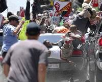 The city of Charlottesville was engulfed by violence Saturday as white nationalists and counterprotesters clashed in one of the bloodiest fights to date over the removal of Confederate monuments across the South. ...