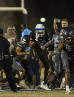 Basic and Canyon Springs players and coaches come to blows on the field as police move in with pepper spray following their game on Friday, September 15, 2017.