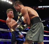 WBC/WBA/IBF middleweight champion Grennady Golovkin, left, of Kazakhstan and Canelo Alvarez of Mexico celebrate after a 12-round title fight at T-Mobile Saturday Saturday, Sept. 16, 2017.
