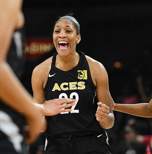 Cambage, Wilson help Aces beat Mercury, clinch No. 4 seed