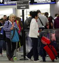 America's busiest airport, Atlanta's Hartsfield-Jackson International, is a blur of activity on the best of days. But an extra layer of anxiety gripped the airport Friday, the eve of a three-day holiday weekend. The partial government ...