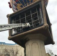 Firefighters rescued a worker who fell today inside the balloon-shaped sign atop the marquee at the Paris Las Vegas, according to the Clark County Fire Department. The worker ...