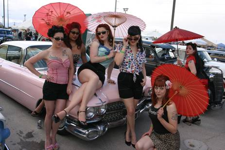Pin up girls on vintage car