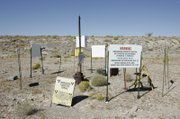 Atop Yucca Mountain, 90 miles northwest of Las Vegas, signs warn of possible radiation near a test well.