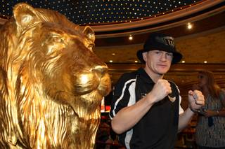 Junior welterweight boxer Ricky Hatton of Britain poses during his official