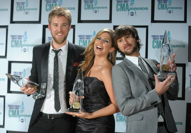 From left, musicians Charles Kelley, Hillary Scott and Dave Haywood of the band Lady Antebellum pose backstage with their New Artist of the Year award at the 42nd Annual CMA Awards in Nashville, Tenn., on Wednesday, Nov. 12, 2008. Scott celebrated her birthday -- and her group's nomination as vocal group of the year -- at The Bank in Las Vegas the weekend of April 3-5, 2009.