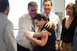 Reporter Joe Brown embraces reporter Alexandra Berzon as she returns to the newsroom and learns of the Las Vegas Sun's win of the Pulitzer Prize for public service for exposing a high death rate among construction workers on the Las Vegas Strip, at the Las Vegas Sun offices in Henderson, Nevada on Monday, April 20, 2009.