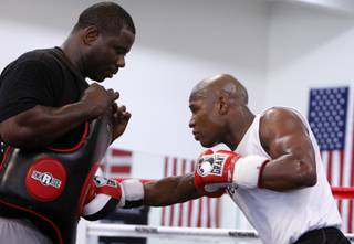 Floyd Mayweather Jr., right, works out with Nate Jones during an open workout at his Las Vegas gym Wednesday. Mayweather is preparing for his upcoming fight with Juan Manuel Marquez on Sept. 19 at the MGM Grand Garden Arena.