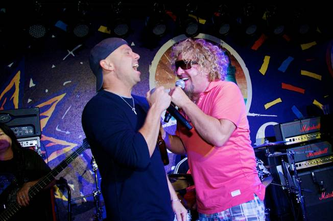 Kenny Chesney and Sammy Hagar duet at Sammy's grand opening of Cabo Wabo Cantina at Planet Hollywood's Miracle Mile on Dec. 4, 2009.