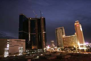 The Fontainebleau, construction stopped, is seen dark along the Strip.