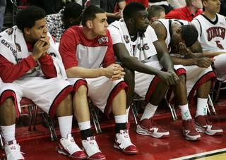 UNLV players, from left, Steve Jones, Mychal Martinez, Brice Massamba and Matt Shaw react during the closing seconds of Saturday's game against Utah. UNLV lost the game 73-69.