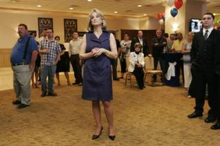 Sue Lowden watches election results come in at a primary election party for the Senate candidate Tuesday, June 8, 2010.