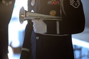 Nellis Honor Guard Taps player Staff Sgt. Ryan Dougherty prepares ...