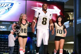 Sacramento Mountain Lions quarterback Daunte Culpepper walks down the runway in his team's new uniform Wednesday at the Fashion Show Mall. The UFL held an event to unveil all five teams' uniforms for the 2010 season.
