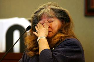 Costco customer Karen Passarelli-Krause wipes away a tear while testifying during a coroner's inquest for Erik Scott at the Regional Justice Center Saturday, September 25, 2010.