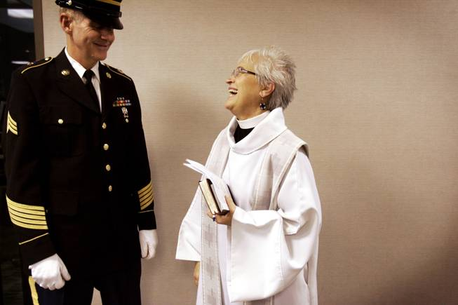 Reverend Mary Bredlau chats with bugler Sgt. Richard Dalton of the Nevada Honor Guard before a funeral at Palm Mortuary on Easter and Warm Springs in Las Vegas December 22, 2010.