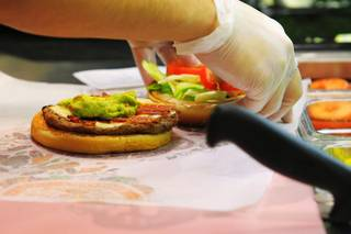 A California Whopper is assembled during the opening of the Burger King Whopper Bar Friday, April 8, 2011 in the Rio.