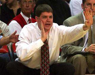 UNLV assistant coach Dave Rice yells to Rebel players as they take on Georgetown at the Thomas & Mack Center Sunday, November 28, 1999. The Rebels defeated the Hoyas 85-69.