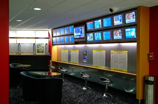 A look inside a William Hill betting shop. The British company, known for offering better odds and taking bigger bets than Las Vegas books, is buying American Wagering Inc., which operates Leroy's sports books.