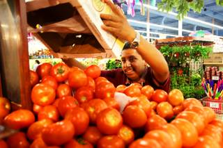 Misael Barrera stocks the produce at Cardenas Market on Meadows Lane on Saturday, May, 28, 2011. Cardenas, which caters to the Hispanic population, is thriving in this down economy.