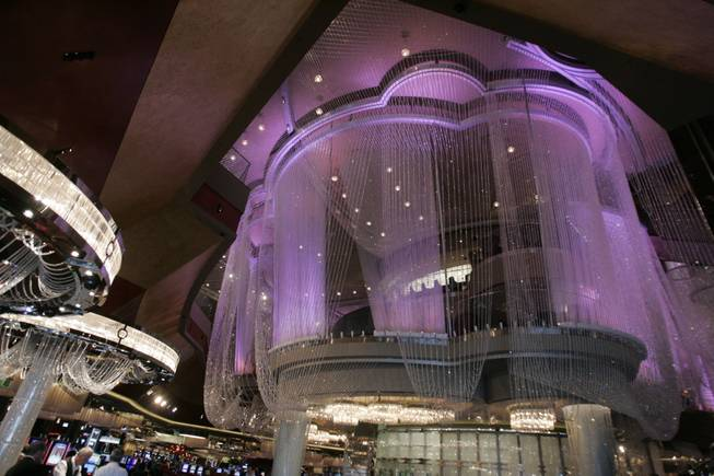 In the center of the casino floor sits Cosmopolitan's literal crown jewel. The Chandelier is a three-tiered bar and lounge encased by two million crystals dripping in strands from the ceiling almost to the floor, creating the sense of a fantastical, inhabited chandelier.
