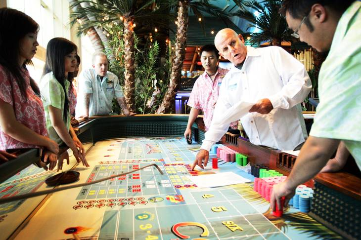 A floor supervisor trains the craps table dealers at the Margaritaville casino inside the Flamingo on Friday, Sept. 30, 2011.