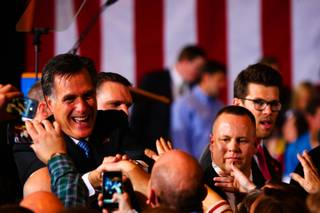 Surrounded by U.S. secret service agents, Republican presidential candidate Mitt Romney shakes hands with supporters at the Nevada Republican caucus Saturday, Feb. 4, 2012, at the Red Rock Hotel and Casino in Las Vegas.