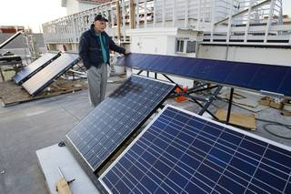 Robert Boehm, director for the Center for Energy Research at UNLV, stands by a variety of photovoltaic panels used for teaching on the roof of the engineering building at UNLV Wednesday, Feb. 22, 2012.