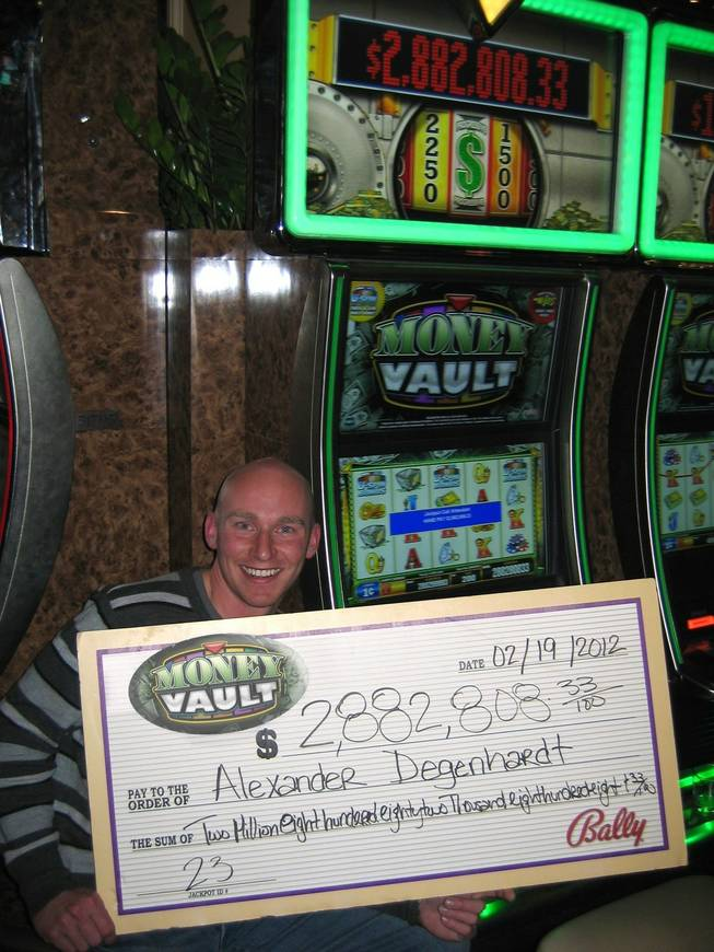 Alexander Degenhardt, a U.S. Marine stationed in Washington, D.C., won a $2.8 million progressive slot machine jackpot Sunday, Feb. 19, 2012, at the Bellagio.