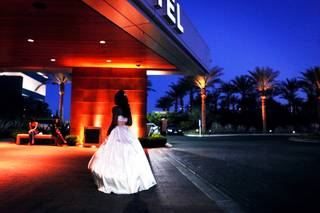 Senior Jayla Lewis walks into Mojave High School prom at Aliante Station in North Las Vegas on Saturday, April 21, 2012.