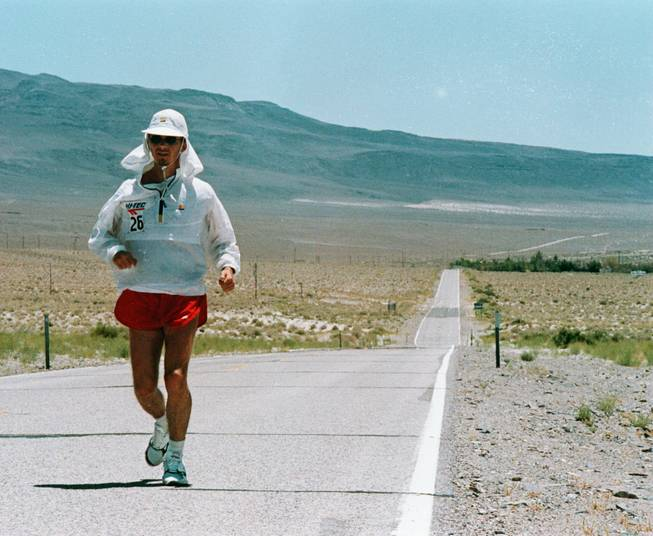 A man runs along Highway 136 during the the Death Valley Marathon. Upcoming running events in Death Valley National Park are scheduled for February. People who don't want to wait for winter to see the beauty of the national park can go to Furnace Creek Resort to play a round of golf.