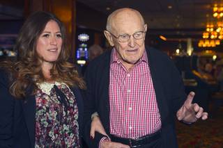 Las Vegas gaming pioneer Jackie Gaughan arrives with Alexandra Epstein, executive vice president of the El Cortez, as he celebrates his 92nd birthday with a champagne and cake celebration at the El Cortez in downtown Las Vegas, Wednesday, Oct. 24, 2012.