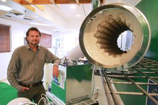 Jon Harms and his EcoDitioner cooling system, with a view inside the ceramic matrix cooling core, Thursday, Nov. 2, 2012.